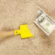 Money american hunderd dollar bills in sand and yellow shovel — Stock Photo