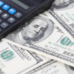 Calculator on money american hundred dollar bills - horizontal — Stock Photo #37952451