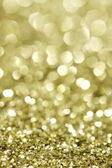 Abstract holidays brass lights on background - vertical — Stock Photo