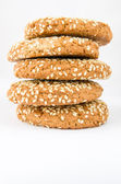 Oatmeal cookies with sesame seeds on a white background — Stock Photo