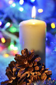 Christmas candle and pine cone — Stok fotoğraf