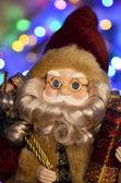 Santa claus con regalos — Foto de Stock