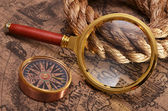 Ancient map and magnifying glass — Stock Photo