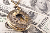 Pocket watch on money — Stock Photo