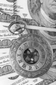 Pocket watch on money — Stock Photo