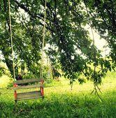 Wooden swing for children — Stock Photo