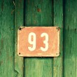 Stock Photo: Old signs - house number