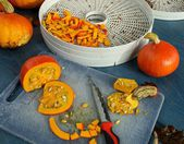 Autumn in the garden - hokkaido pumpkin, apples and nuts — Stock Photo