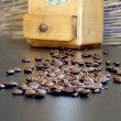 Coffee grinder and coffee beans — Stock Photo