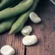 Broad Beans on a wooden Table — Stock Photo