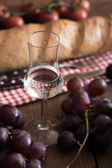 Grappa with Grape, Bread and Tomatoes — Stock Photo