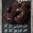 Old Boxing Gloves on Chalkboard with Tally Sheet — Stock Photo #35797663