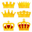 Set of gold crowns on white background — Stock Vector #33558699