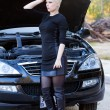 Stock Photo: Blond WomRepairs Car