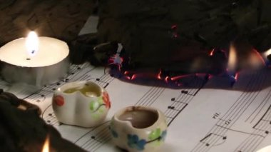 Music notes and Candles are burning — Vídeo Stock