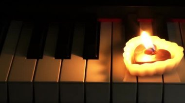 Heart Shape Candle on Piano — Stock Video