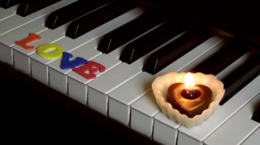 Love on Piano Keys and Candle Light — Stock Video