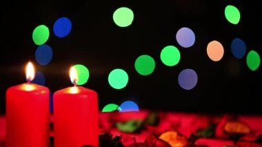 Red Candles and Bokeh Colorful Lights — Stock Video