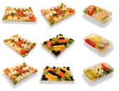 Food set for first class air passengers over white with shadow — Stock Photo