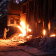 Smelting metal in a metallurgical plant. Liquid iron in the ladl — Stock Photo