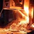 Rare close view of working open hearth furnace at the metallurgi — Stock Photo