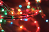 Christmas garland Christmas lights on wooden background. Selective focus — Stock Photo