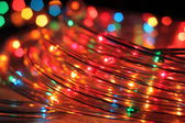 Christmas garland Christmas lights on wooden background. — Stock Photo