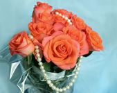 Pearls and colorful flowers roses — Stock Photo