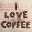 Inscription I love coffee from beans on wood — Stock Photo