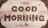 The inscription on wood a good day with many grains of coffee — Stock Photo