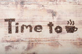 Inscription from coffee beans on wood Time to coffee — Stock Photo