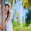 Young girl with palms — Stock Photo