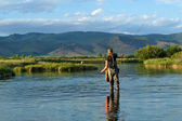 Fly fishing for trout in a spring fed creek in Idaho — Stock Photo