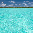 Clear tropical water in front of island — Stock Photo