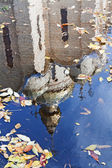 A reflection of the church building in water — Stock Photo