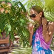 Young woman in sunglasses on vacation — Stock Photo