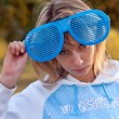 Portrait of a young girl with funny sunglasses — Stock Photo