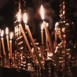 Stock Photo: Church candle flame on a dark background