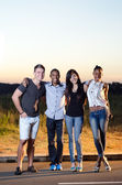 Friends smiling at sunset 2 — Stock Photo