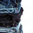 Many different denim jeans on a white background — Stock Photo