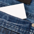 Jeans pocket with a credit card or calling card — Stock Photo