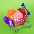 Concept of discount. Shopping cart with sale. — Stockfoto