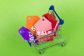 Concept of discount. Shopping cart with sale. — Stock Photo