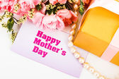 Pink carnations and mother's Day gift, greeting cards. — Stock Photo