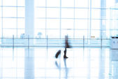Futuristic Airport interior people walking in motion blur — Stock Photo