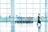 Futuristic Airport interior people walking in motion blur — Stock Photo
