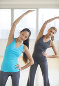 Women Doing Stretching Exercise At Gym — Stock Photo
