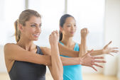 Woman Doing Stretching Exercise With Female Friend — Stock Photo