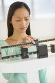 Woman Adjusting Balance Weight Scale — Stock Photo