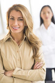 Beautiful Businesswoman Standing Arms Crossed In Office — Stock Photo